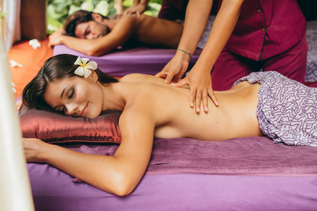 Couple having body massage at day spa