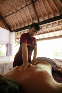 Man getting back massage at spa resort