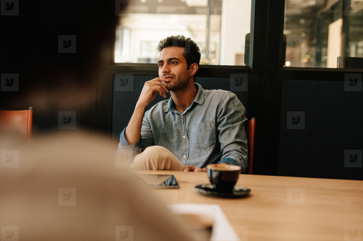 Man during business meeting in conference room