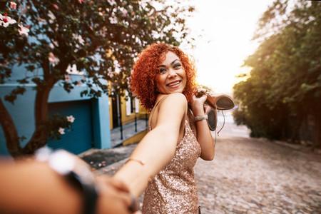 Happy young woman having fun walking on street