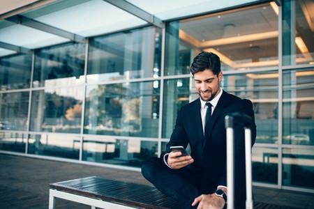 Caucasian businessman waiting in airport terminal