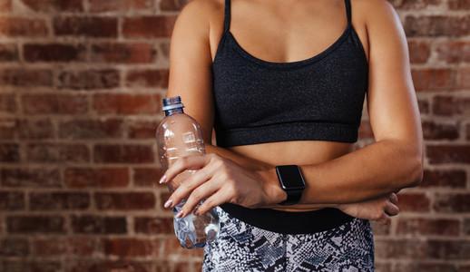 Woman in sportswear holding a water bottle