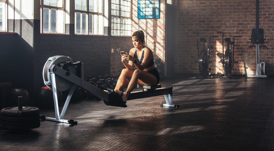 Young woman relaxing during work out at the gymnasium