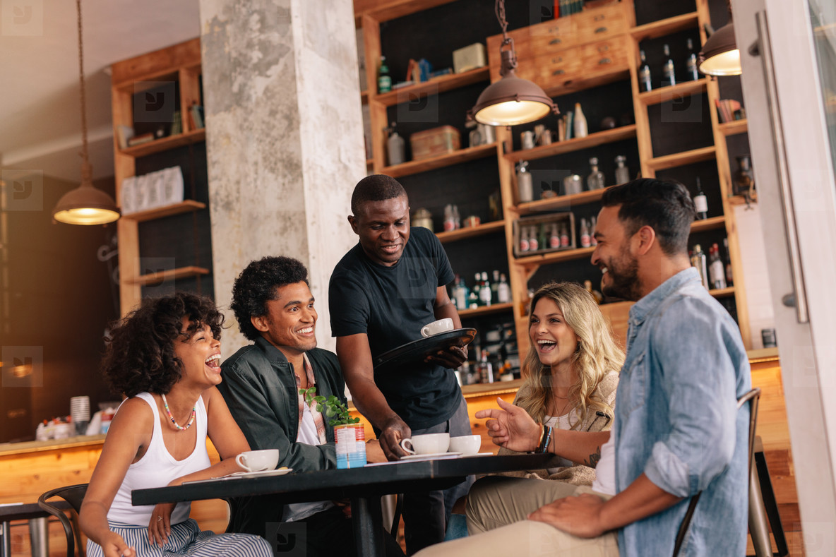 Young people meeting at coffee shop