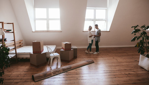 Young couple in love moving in a new apartment