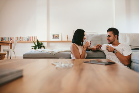 Young couple having coffee at home