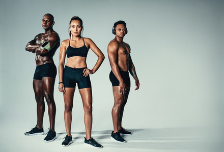Healthy young men and woman with muscular build