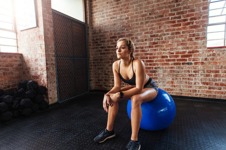 Young woman exercising in gymnasium