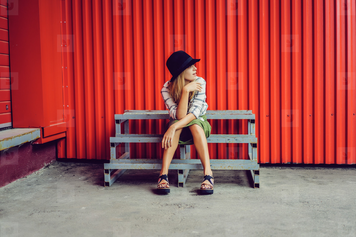 Blond girl in a hat  Street photo  A beautiful girl wearing casu