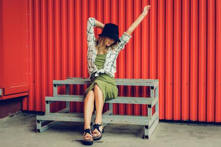 Blond girl in a hat  Street photo  A beautiful girl wearing casu