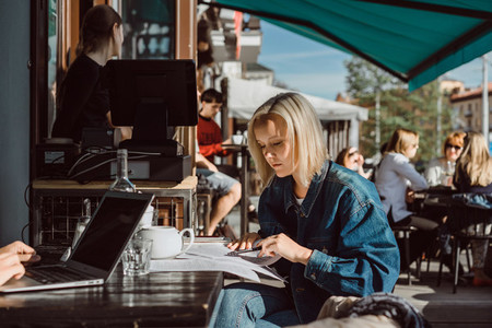 Girl freelancer working in a cafe