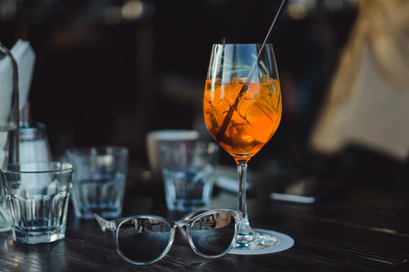 Glasses with wine and cocktail on the table in a cafe
