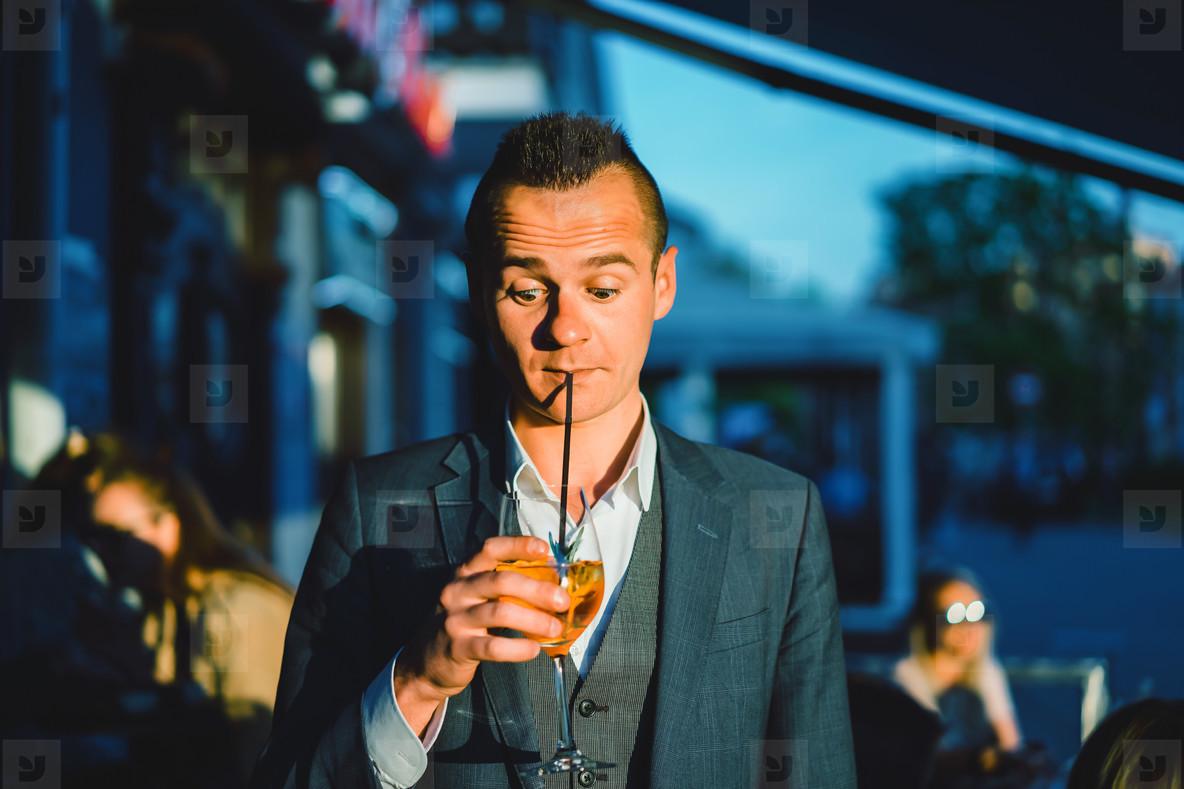 man drink cocktail
