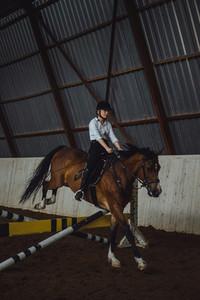 Beautiful girl riding a horse
