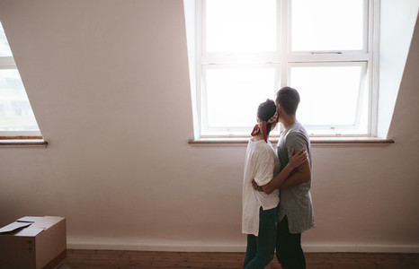 Loving young couple moving in a new apartment