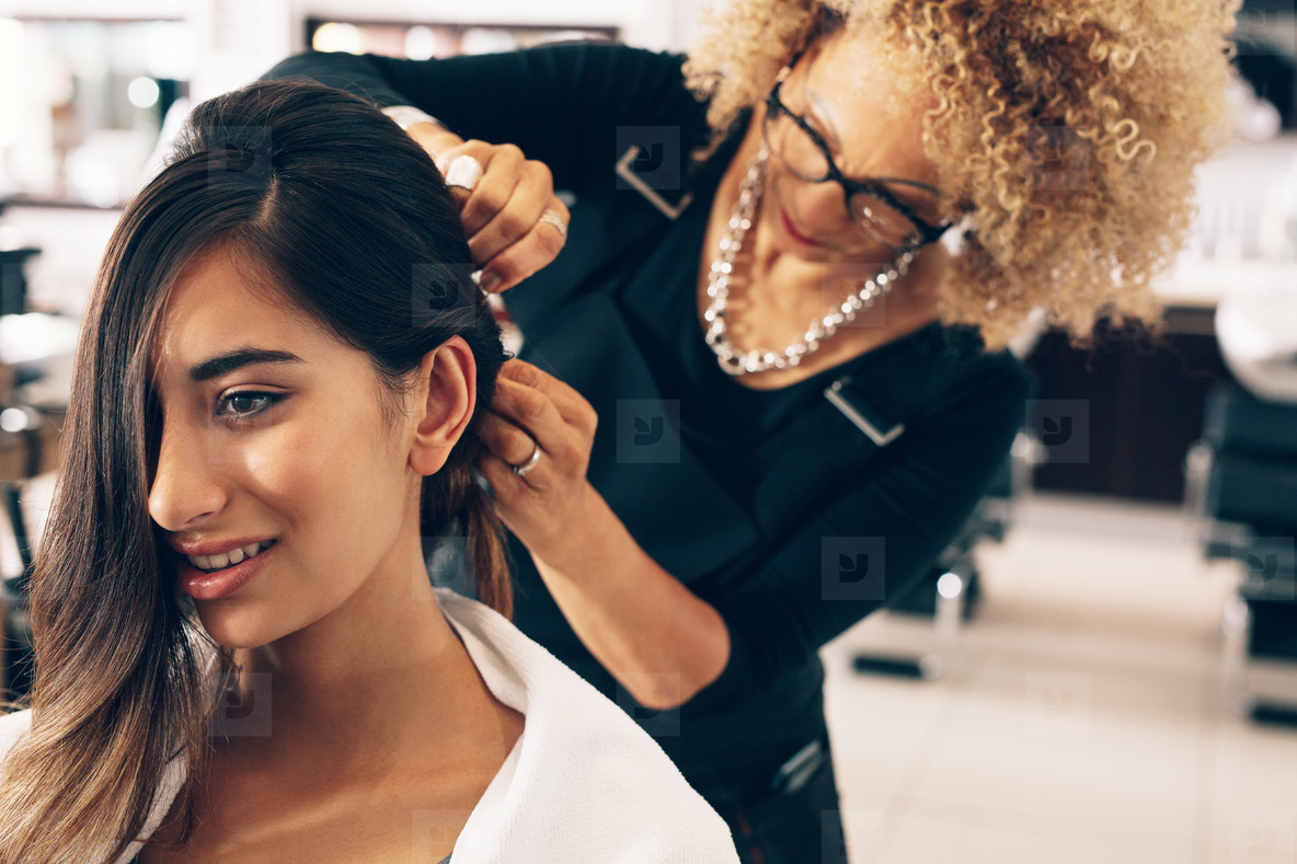 Hairdresser working on a woman  s hair at salon