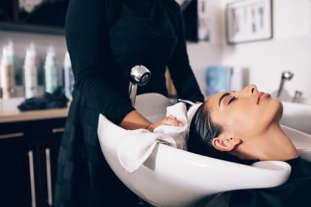 Woman at hair dressing salon getting hair treatment