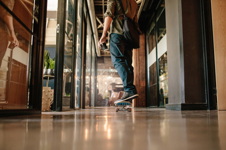 Young man skating through his startup office