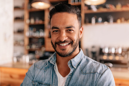 Smiling young man in a coffee shop