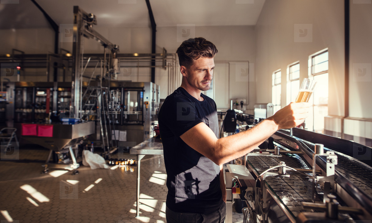 Brewery business owner testing the beer