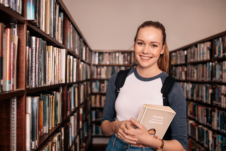 Young female college student in library