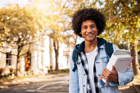Young african student returning from college