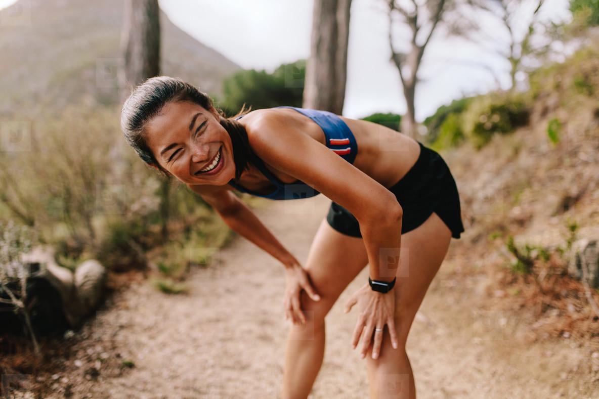 Female runner taking a break after running workout