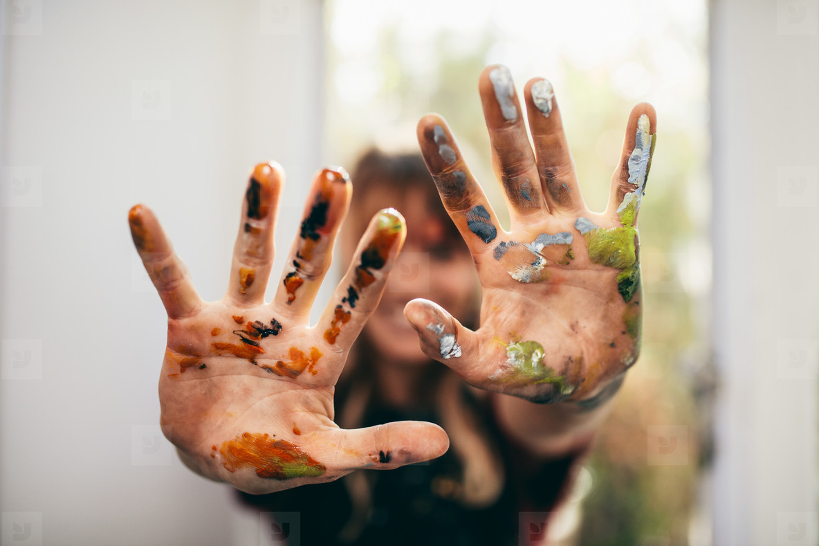 Artist showing her messy hands
