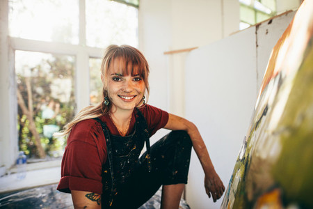 Professional female painter in her studio