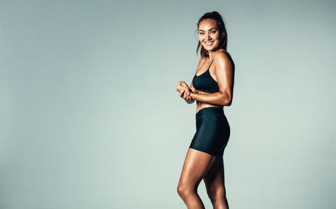 Hispanic female fitness model smiling