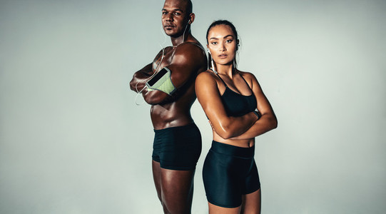 Beautiful athletic couple on grey background