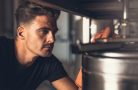 Male brewer working at brewery