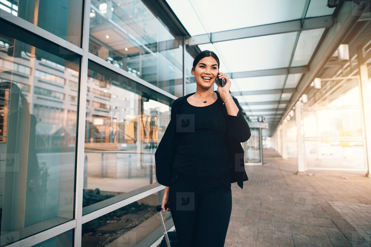Travelling businesswoman making phone call