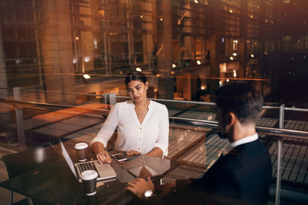 Business people waiting at airport lounge with laptop