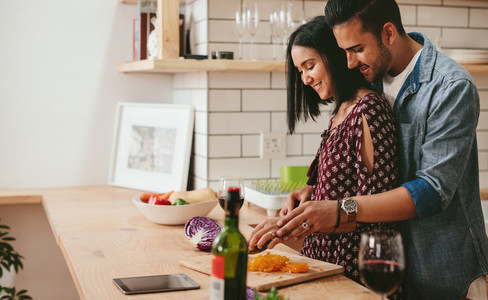 Loving couple cooking in kitchen at home