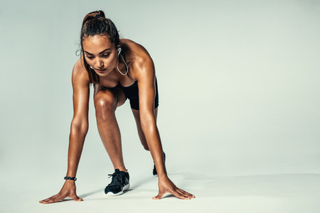 Female athlete in starting position ready for competition