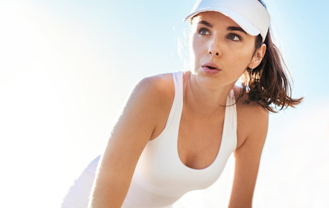 Beautiful tennis player taking a breathe