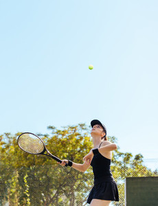 Sportswoman playing tennis on court