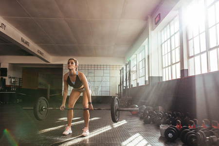 Young woman working out at the gymnasium