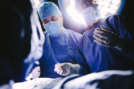 Medical professionals during surgery operating room