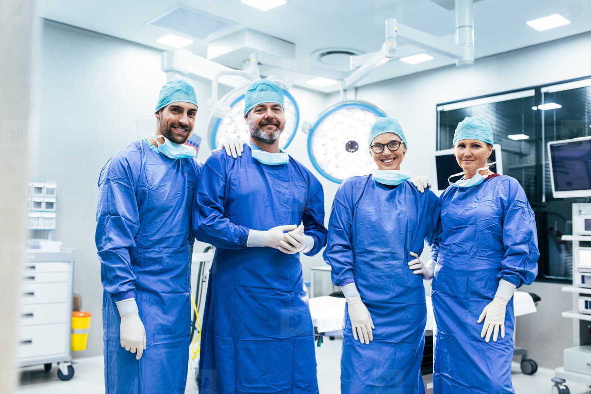 Successful team of surgeon standing in operating room