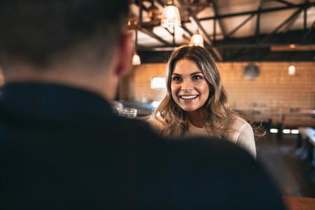 Beautiful young woman with a man at bar