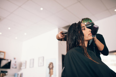Young woman hairdressing at a salon