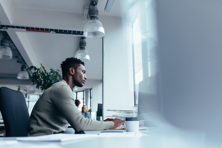 Young african man working in office