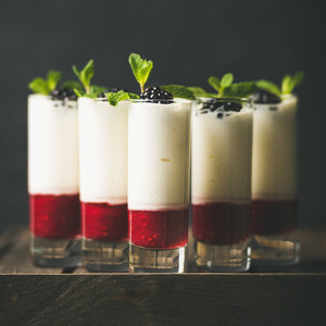 Dessert in glass with blackberries and mint copy space