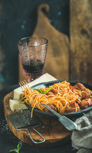 Italian pasta dinner with spaghetti meatballs and red wine