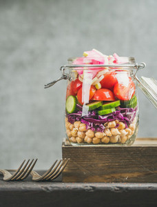 Close up of Healthy layered take away salad with vegetables  chickpea sprouts