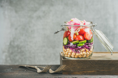 Healthy take away lunch jar with vegetables and chickpea sprouts