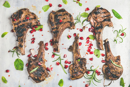 Meat barbecue dinner with grilled lamb ribs and pomegranate  herbs