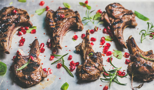 Grilled lamb ribs with pomegranate seeds and herbs